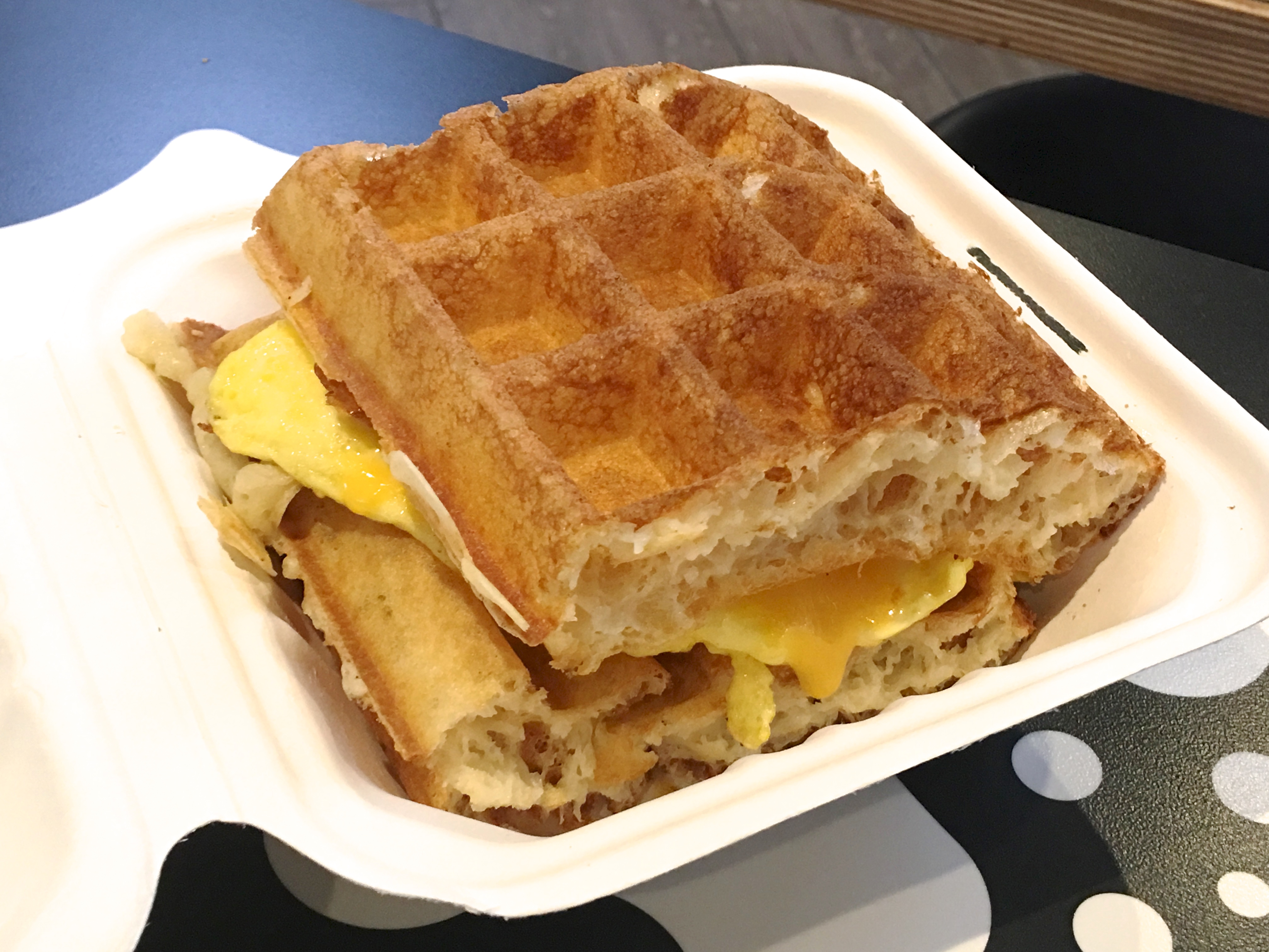 A bacon, egg, and cheese waffle sandwich