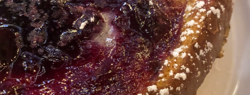 Toast with berry spread and powdered sugar on top
