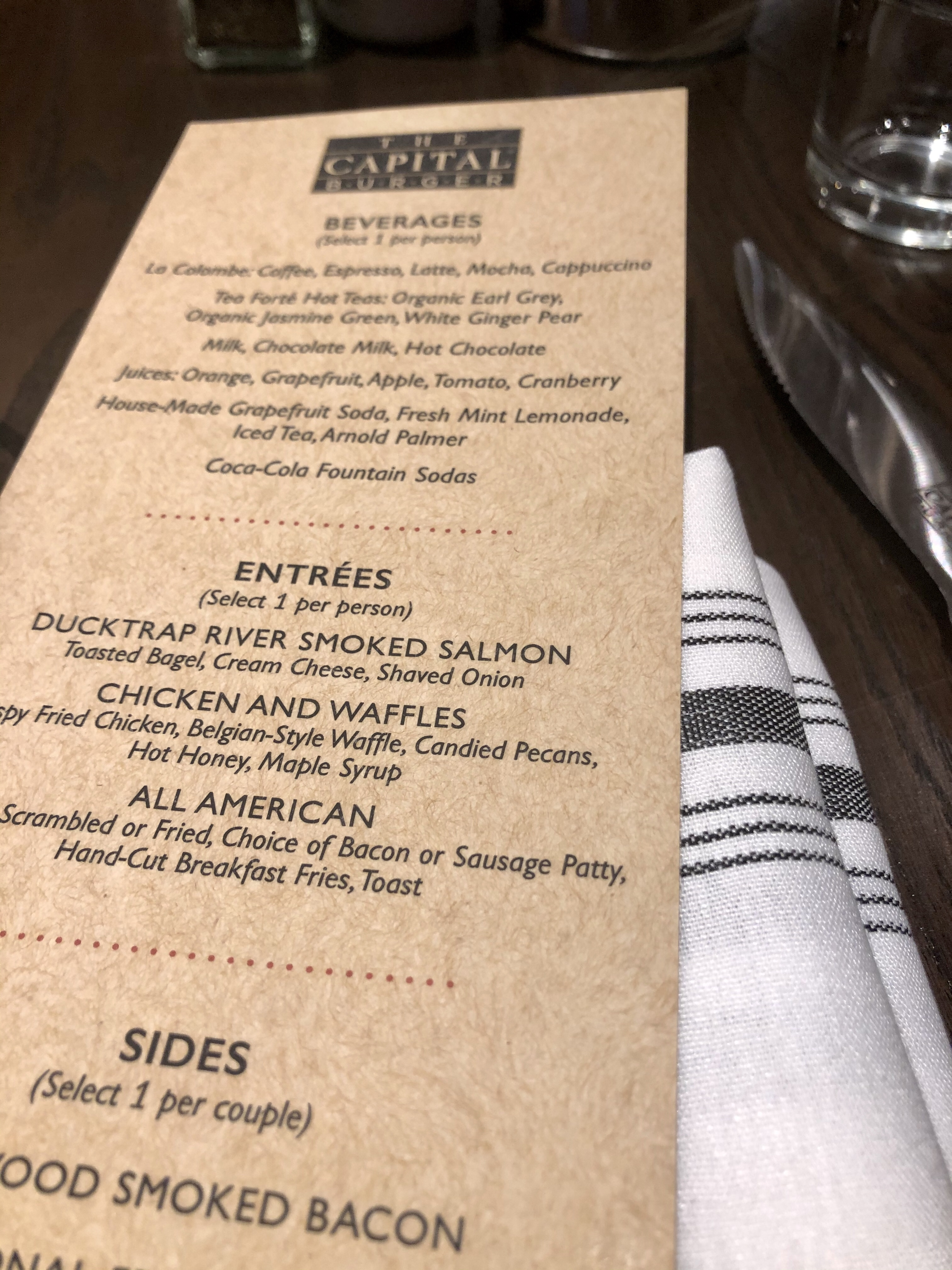 A restaurant menu on a table.