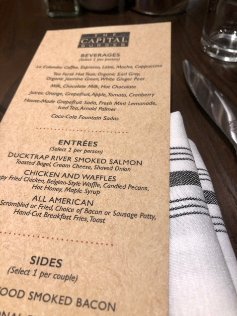 A restaurant menu on a table.